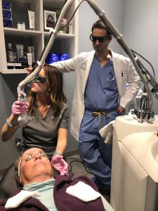 Angela Negron, FNP, performs a Sciton laser skin treatment under the supervision of Dr. Steven Camp